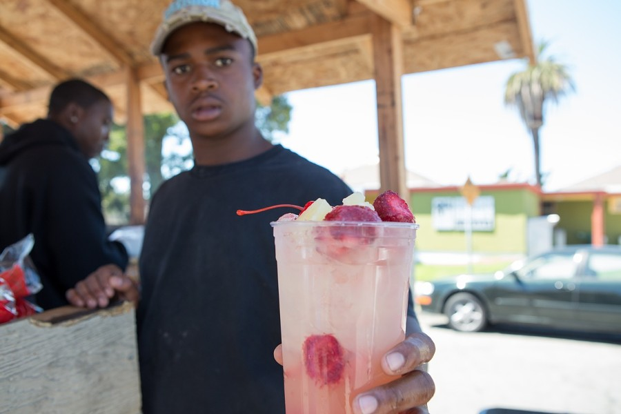 Ramone Curtis sells some strawberry lemonade. - BERT JOHNSON