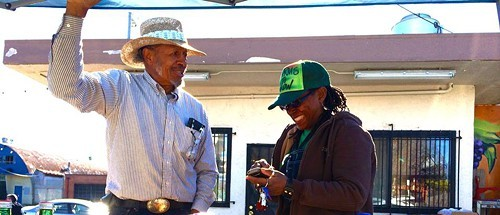 Farmer Will Scott and market organizer Gail Myers at the new Freedom Farmers Market site (via Facebook)