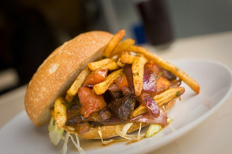 French fries are stuffed into the Niman Ranch hanger steak sandwich.