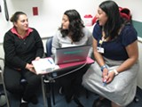 SAM LEVIN - Hayward resident Alicia Ruelas gets assistance at Children's from Jessica Castro and Dayna Long.