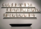 Hopi Breton's sculpture suggests cuneiform.