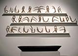 Hopi Breton's sculpture suggests cuneiform.
