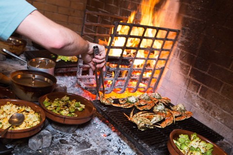 Local restaurants that specialize in Dungeness crab prepare the delicacy in a variety of ways. At Camino, they are seasoned and roasted over coals.