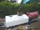 JETTON CONSTRUCTION - Installation of the 2,500-gallon tank buried in the backyard.