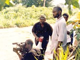 Izu Ojukwu (with bullhorn) in a still from Welcome to Nollywood.