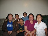 KARA PLATONI - Jackie Saephanh (left) with four of her siblings and her mother, Fahm Phanh,  want a Lao-language warning system.