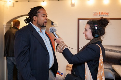 "Jason ""Shake"" Anderson gives an interview at Libby Schaaf's election party. - BERT JOHNSON"
