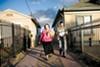 Jean Quan and her son, William Huen, walking a voting precinct in Oakland's Fruitvale district.