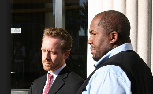 Jovan Jackson (right) with lawyer