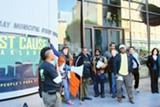 JUST CAUSE - Just Cause activists rallied at East Bay MUD headquarters in downtown Oakland.