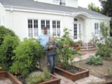 NATE SELTENRICH - Kay Kewley and Wayne Lyons show off their edible garden.