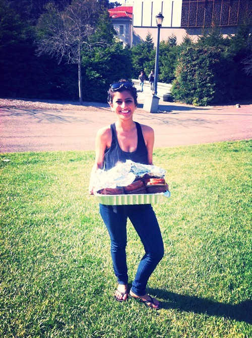 Komal Ahmad picks up some food.