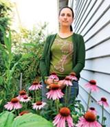 MAYA SUGARMAN - Laura Allen in her well-watered garden.