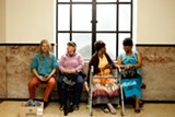 ERIKA PINO - Litigants wait for their turn in court on a recent Friday in Oakland.