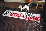 JARED GRUENWALD - Lyta, Renee Dyer's dog, stands by a sign made by tenants of 138 Monte Cresta. The new owner banned all dogs from the building