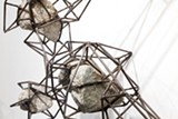 Mark Baugh-Sasaki encaged stones in steel armatures.