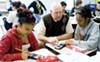 Matt Bremer helps freshmen at Community Partnerships Academy with their integrated math curriculum.