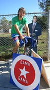 Matthew Szymankowski on his stationary bike in Temescal, reminding his neighbors to vote