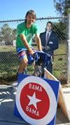 Matthew Szymankowski on his stationary bike in Temescal, reminding his neighbors to vote