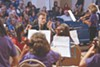 Michel Taddei with the Crowden School's Lower School Orchestra.