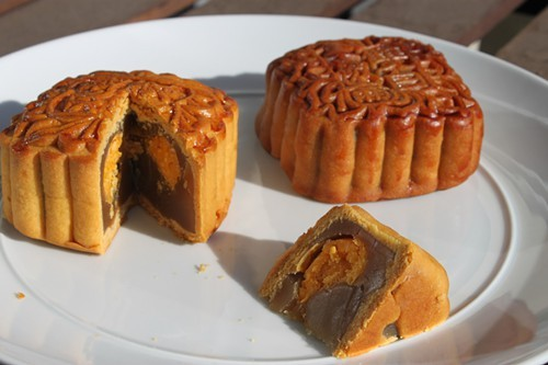 Mooncakes from Wonder Food Bakery (left) and Napoleon Super Bakery