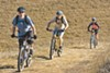Mountain bikers say the East Bay Regional Parks District has provided poor access to its land and allowed cattle grazing to crowd out other uses.