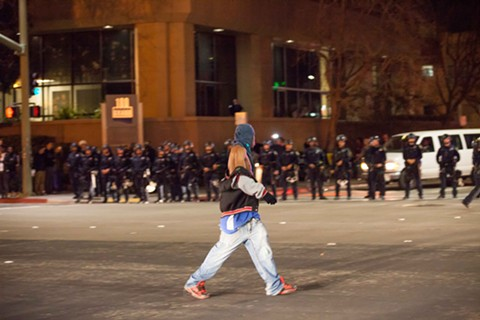 A lone demonstrator faces off with the police after they ordered marchers to disperse.