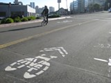 NATE SELTENRICH - New sharrows on Webster Street offer bicylists an easy route through Uptown.