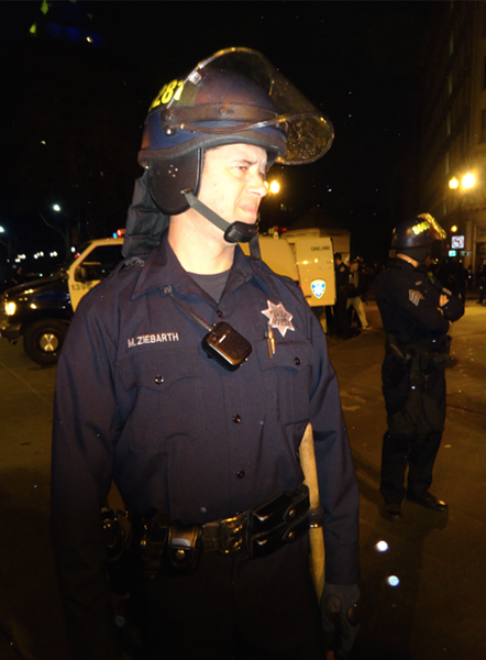 Officer Martin Ziebarth said he normally investigates human trafficking, but on Sunday was assigned to enforce the new ban against nighttime street demonstrations. - DARWIN BONDGRAHAM