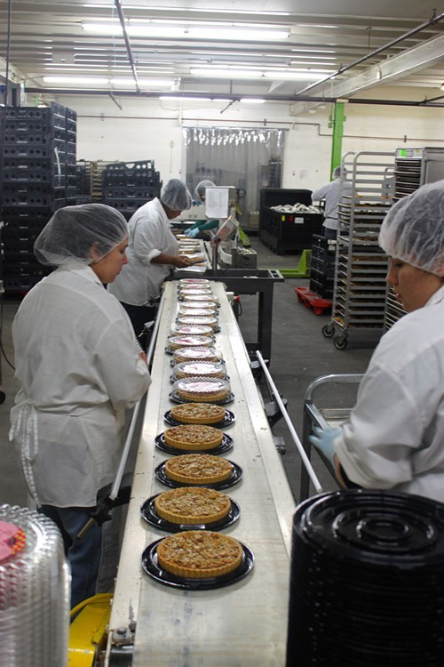 Packaging cakes at Rubicon Bakerys manufacturing facility.