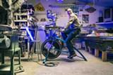 STEPHEN LOEWINSOHN - Paul Freedman tests a bike-powered LED at Rock the Bike.