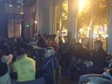 ELLEN CUSHING - People groaned and heckled while watching the presidential debate.