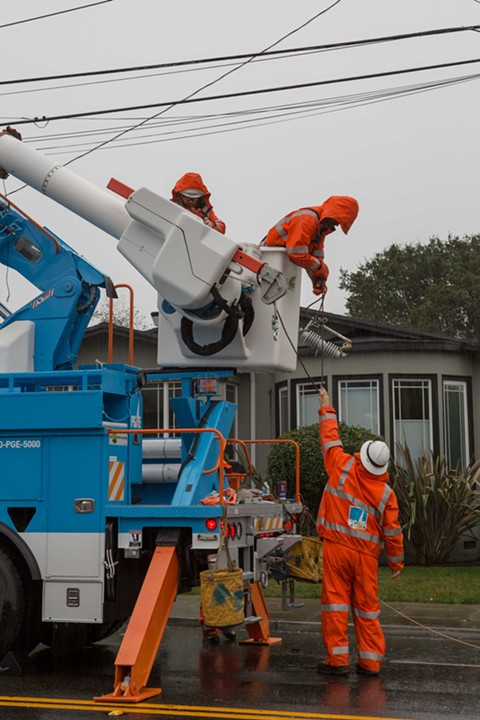 PG&E workers repair downed power lines on Ashby Ave. - BERT JOHNSON