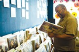 STEPHEN LOEWINSOHN - Phillip Davis browses for records at Dave's Record Shop.