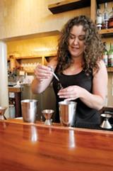 RANDY DARDEN - Pizzaiolo bartender Hana Hayashi makes a cardamom gimlet.