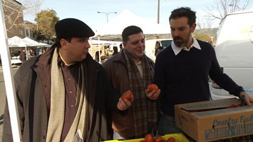 Pizzaiolos Charlie Hallowell (right) shows off some farmers market persimmons during the premiere episode of Pizza Cuz.