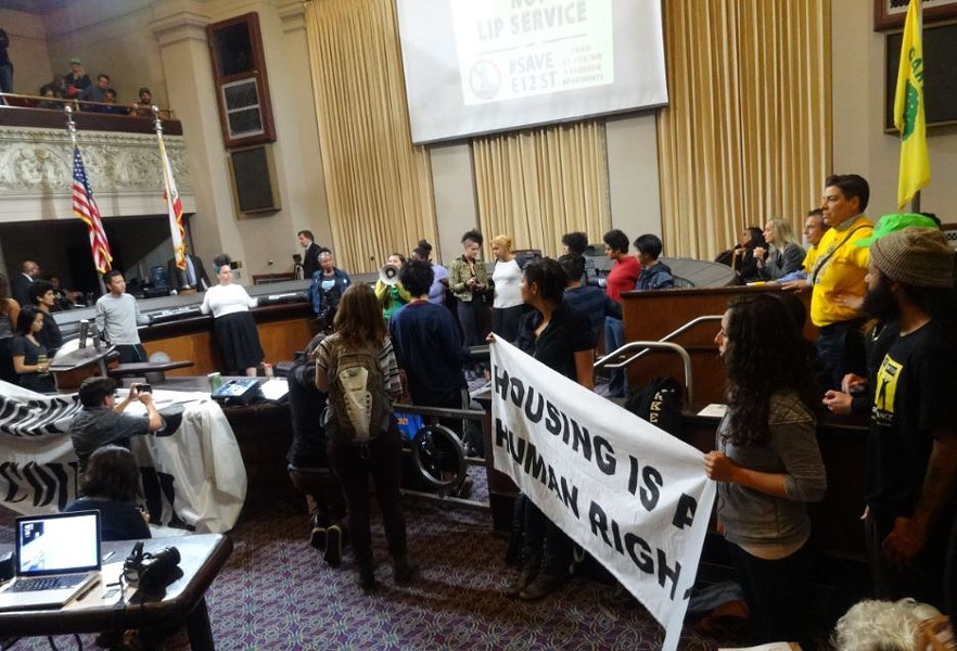 Councilmembers Campbell-Washington, Gallo, and Kaplan listened to protesters after the Oakland City Council meeting was adjourned. - DARWIN BONDGRAHAM