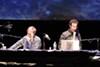 <i>Radiolab</i>'s Robert Krulwich and Jad Abumrad on stage.