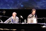 Radiolab's Robert Krulwich and Jad Abumrad on stage.
