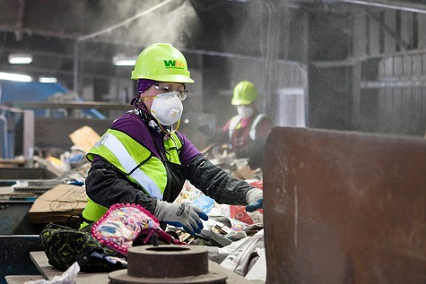 Recycling workers at the Davis Street transfer station have difficult and dangerous jobs.