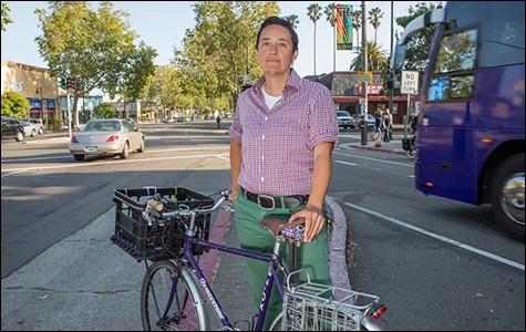 Renee Rivera, Bike East Bay's executive director, on Telegraph Avenue. - BERT JOHNSON / FILE PHOTO