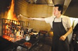 CHRIS DUFFEY - Russell Moore works the oven at Camino.
