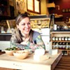 Sacred Wheel co-owner Jena Davidson stocks a variety of local cheeses.