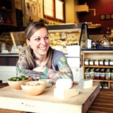 STEPHEN LOEWINSOHN - Sacred Wheel co-owner Jena Davidson stocks a variety of local cheeses.