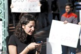 MOHAMED EL-GEISH - Salma Mousallem uses her cell phone at a UC Berkeley rally.