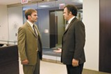 Seann William Scott (left) and John C. Reilly duke it out for a coveted manager's position in The Promotion.