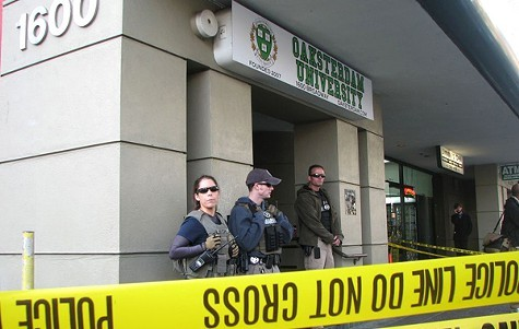 This week, California police poisoned a compromise bill to return unlawfully seized medical marijuana. Above, authorities raid Oaksterdam University in Oakland. - DAVID DOWNS