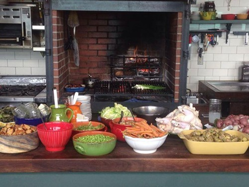 Setup for one of Homesteads family-style Sunday Suppers (via Facebook)