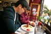 Seung Jung Jin and Tony Lee prepare to enjoy Muracci's curry, the perfect comfort food.