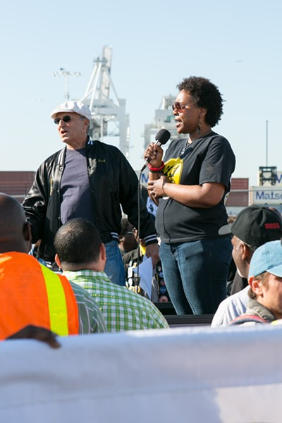 Stacey Rodgers, a rank and file member of the ILWU Local 10, speaking at the port shutdown. - BERT JOHNSON